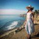 girl on mountain look at ocean in california