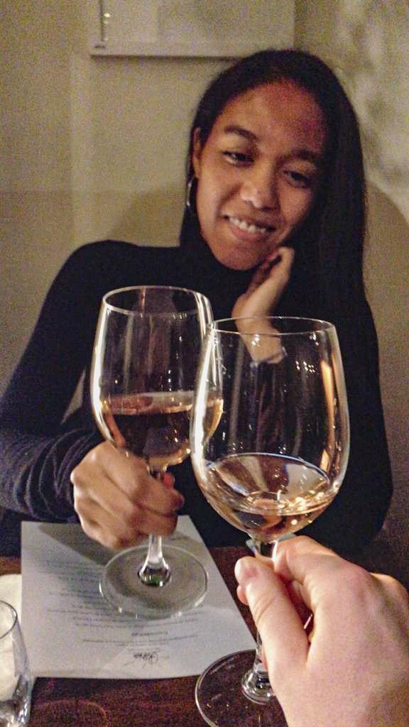 girl drinking wine with Dutch Guy